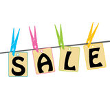 Sale tags  with clothes pegs Stock Image