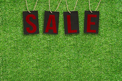 Sale Tags on Green Grass Stock Images