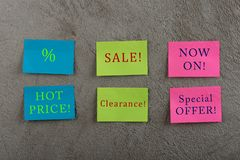 Sale Tags - Many colorful sticky note with text Sale, Hot Price, Now On, Special Offer, Clearance and discount sign. On grey cement background royalty free stock photos