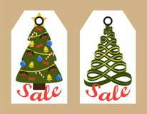 Sale Decorative Tags with New Year Decorated Trees. Sale tags with New Year decorated and abstract Christmas trees hanging sticker badges, shopping promotional Stock Images