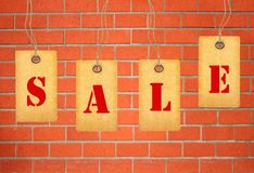 Sale tags over brick wall Stock Photos