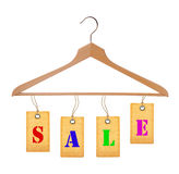 Sale tags on wooden clothes hanger isolated on white Royalty Free Stock Image