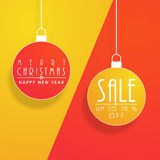 Sale text on hanging X-mas ball for Christmas celebration. Royalty Free Stock Photos