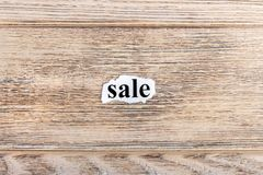 sale text on paper. Word sale on torn paper. Concept Image Stock Images