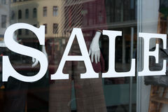 Sale text on shopping window - fashion store Stock Image