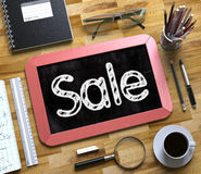 Sale - Text on Small Chalkboard. 3d. Stock Images