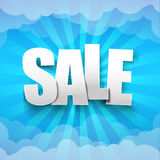 Sale text on sunburst and blue sky and cloud background Stock Photos