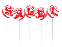 Sale text with sweet lollipops Stock Photos