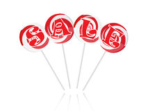 Sale text with sweet lollipops Royalty Free Stock Photos