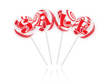 Sale text with sweet lollipops Royalty Free Stock Images
