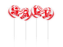 Sale text with sweet lollipops Stock Image