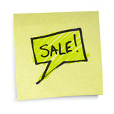 Sale text on yellow sticky paper. Royalty Free Stock Photo