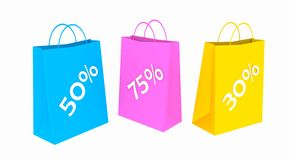 Sale. Three carrier bags, blue marked 50%, purple marked 75% and yellow 30% possibly indicating price reductions in the sale, white background Royalty Free Stock Photography