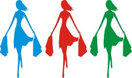 Sale time. Three colorful silhouettes of a young slim and stylish girl in a move bearing shopping bags Royalty Free Stock Image