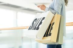 Sale time. Cropped image of woman with bags of things she bought a lot of things on sale Stock Image
