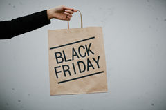 Sale time. Female hand holding paper bag Stock Images