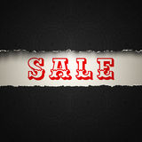 Sale on torn paper Stock Images
