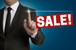 Sale touchscreen is operated by businessman concept Royalty Free Stock Photo