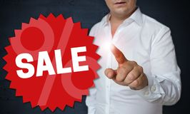 Sale touchscreen is operated by man concept royalty free stock image