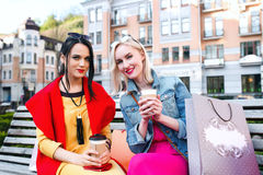 Sale and tourism, happy people concept - beautiful women with Shopping bags stock image