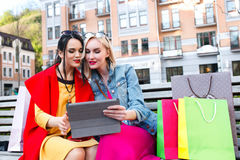 Sale and tourism, happy people concept - beautiful women with Shopping bags royalty free stock images