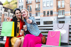 Sale and tourism, happy people concept - beautiful women with Shopping bags royalty free stock photography