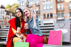 Sale and tourism, happy people concept - beautiful women with Shopping bags stock images