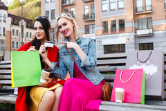 Sale and tourism, happy people concept - beautiful women with Shopping bags Stock Photo