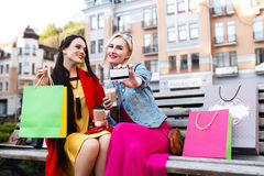 Sale and tourism, happy people concept - beautiful women with Shopping bags Stock Photography
