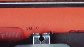 Sale - Typed on a old vintage typewriter. Printed on red paper. The red paper is inserted into the typewriter.  stock video footage