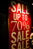 Sale up to 70 percent banner. Single sale up to 70 percent banner in red and yellow under store spotlights at night or inside Royalty Free Stock Images