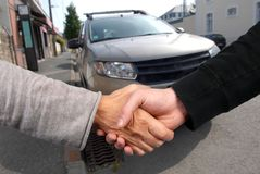 Handshake to conclude the sale of a car. Sale of a used car wwith a handshake stock photo