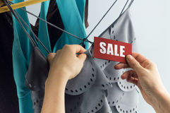 Sale with woman hand Royalty Free Stock Images