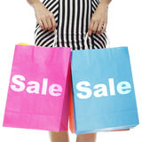 Sale. A woman holding shopping bags indicating Sale Royalty Free Stock Images