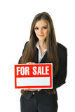For Sale. Woman holding a For Sale sign Stock Photo