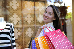 Sale: woman with shopping bags in front of a store Royalty Free Stock Photo