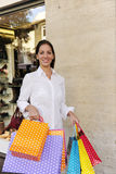 Sale: woman with shopping bags in front of a store Royalty Free Stock Photography