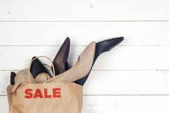 Sale women shoes in high heels and shopping bags Stock Images