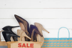 Sale women shoes in high heels and shopping bags Stock Image