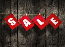 SALE on wood background Stock Photos