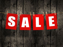 SALE on wood background Royalty Free Stock Photo