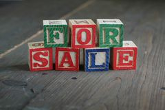 For sale wood blocks Royalty Free Stock Images
