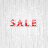 Sale on wooden background Royalty Free Stock Image