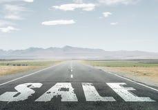 Sale word on asphalt road Royalty Free Stock Image