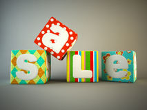 Sale word on colorful fabric cubes Royalty Free Stock Image