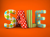 Sale word colorfull fabric on grey background Royalty Free Stock Photo