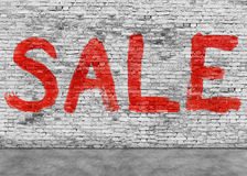 Sale word painted on white wall stock image