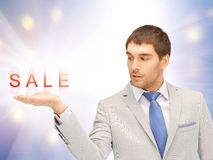 Sale word on the palm Stock Photos