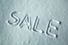 Sale word in snow handwriting Stock Photography