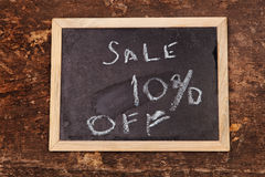 Sale word written on  chalkboard on wooden background Stock Image